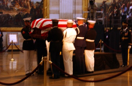 Ceremonial Honor Guard prepare to move the flag-draped casket of former President Ronald Reagan during his state funeral in the U.S. Capitol Rotunda