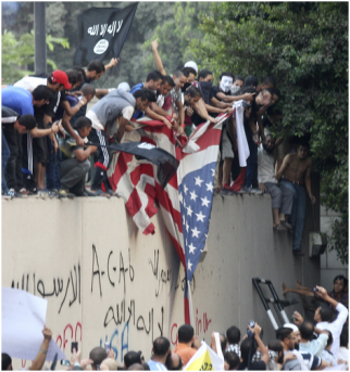 Muslim protesters burning American flag in Egypt